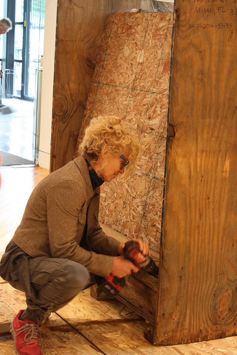 artist Jude Tallichet installing her work