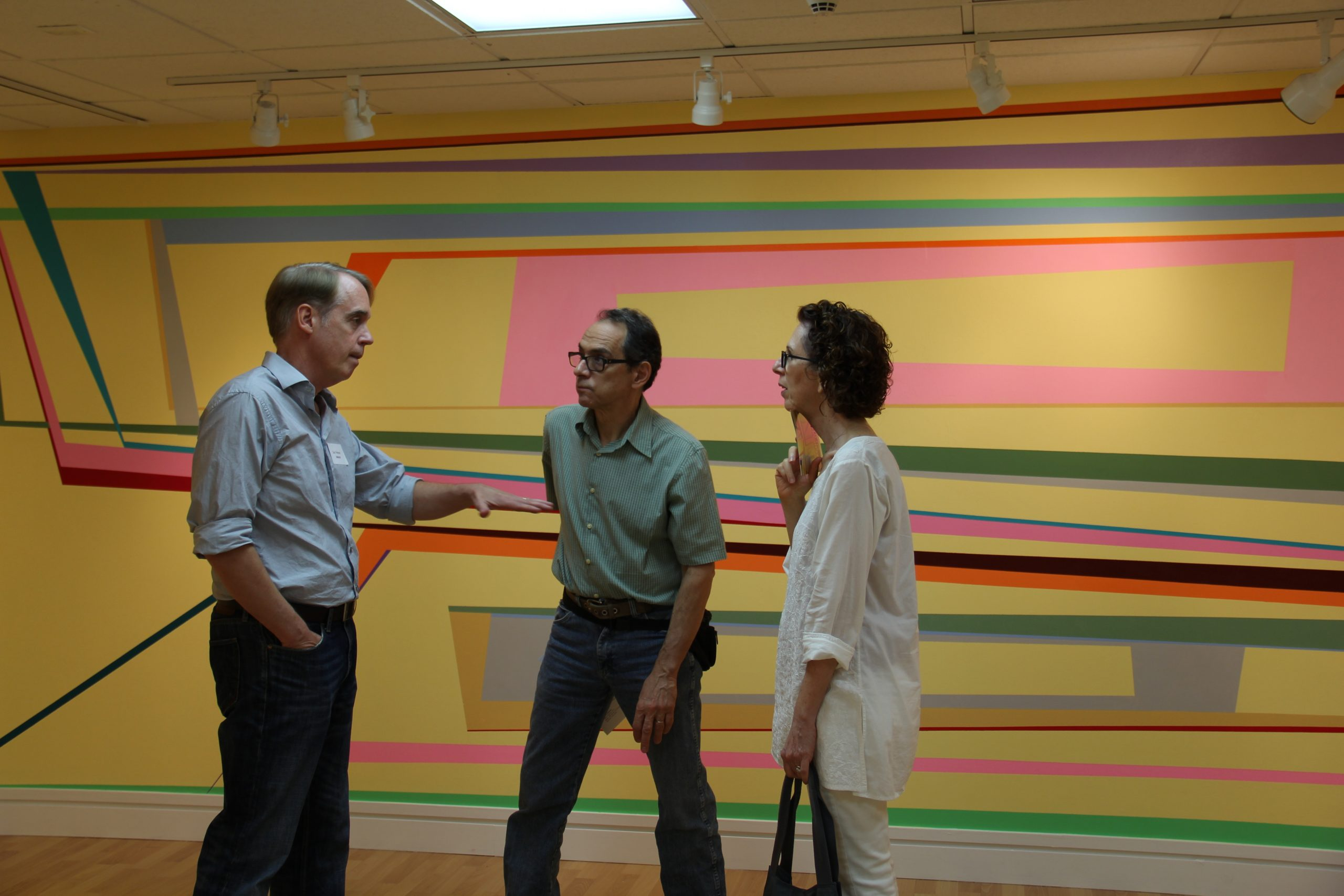 Gary Petersen talking with visitors
