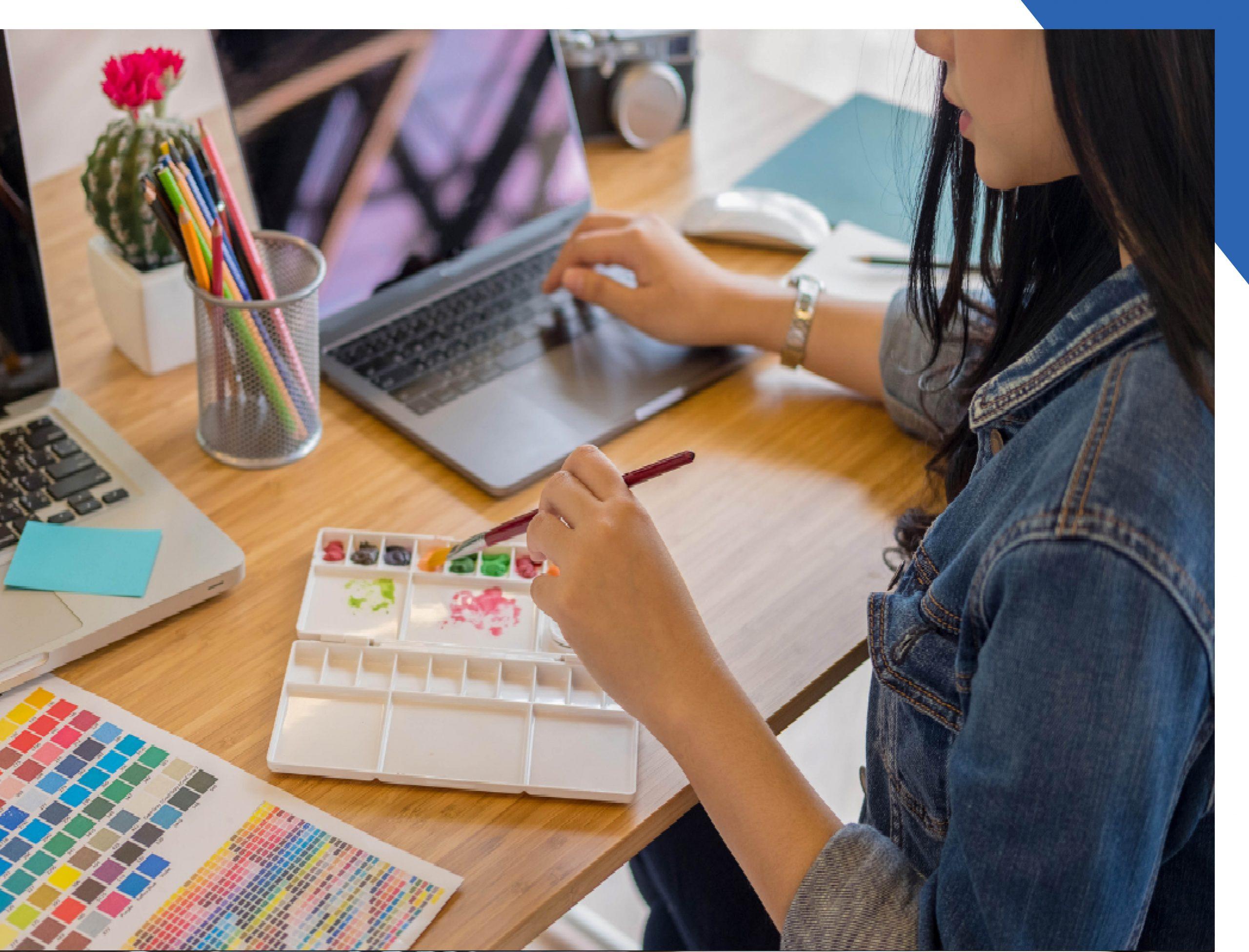 A woman attending a virtual art class