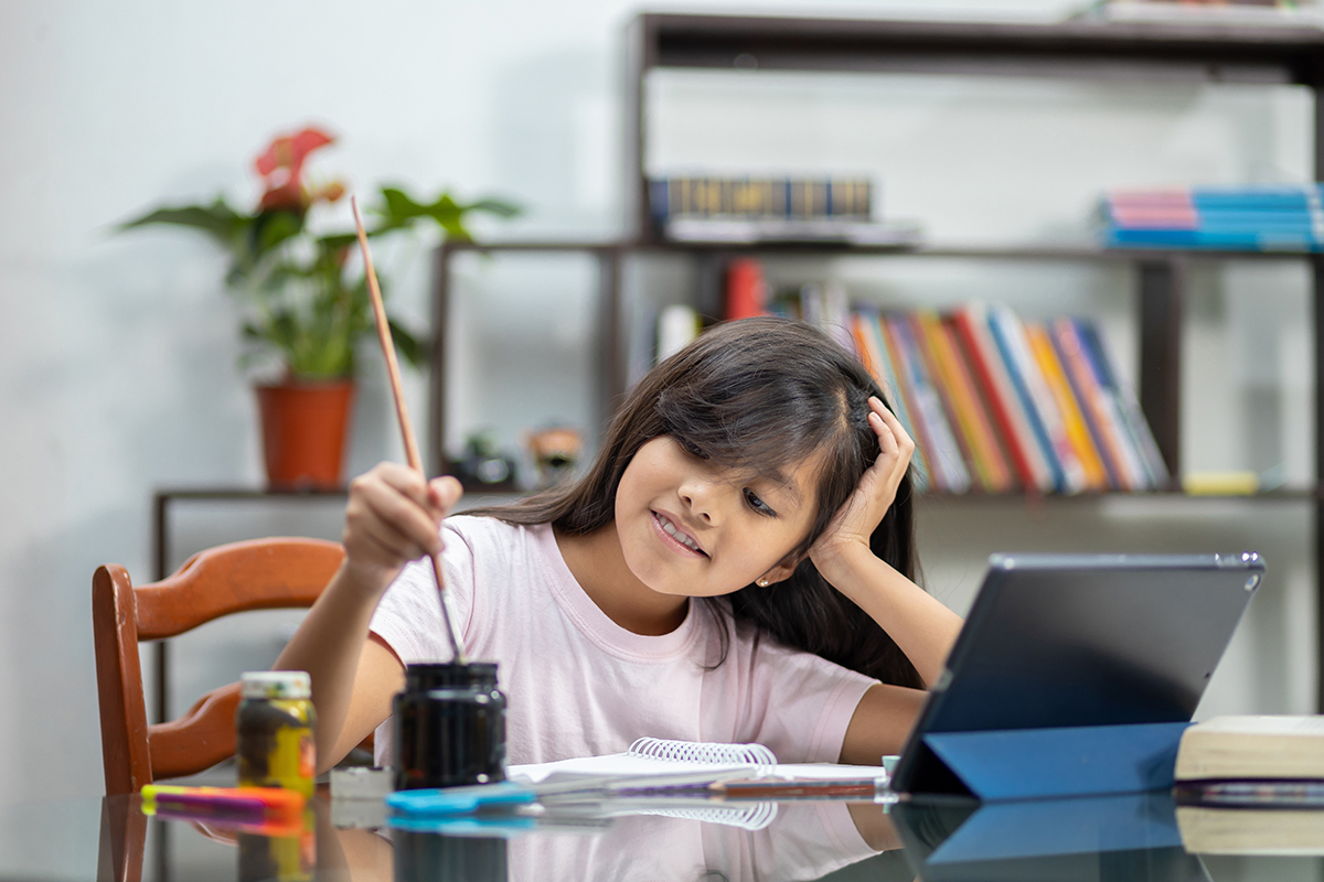 Child artist in front of a computer