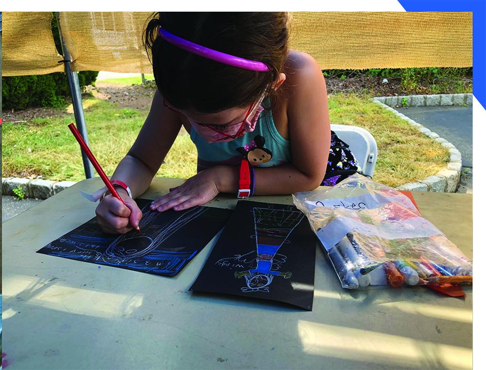 Masked Child Making Art