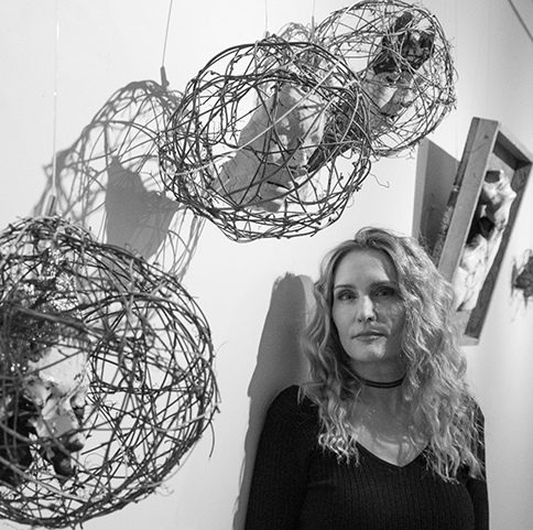 Gianakis posed in front of her work.