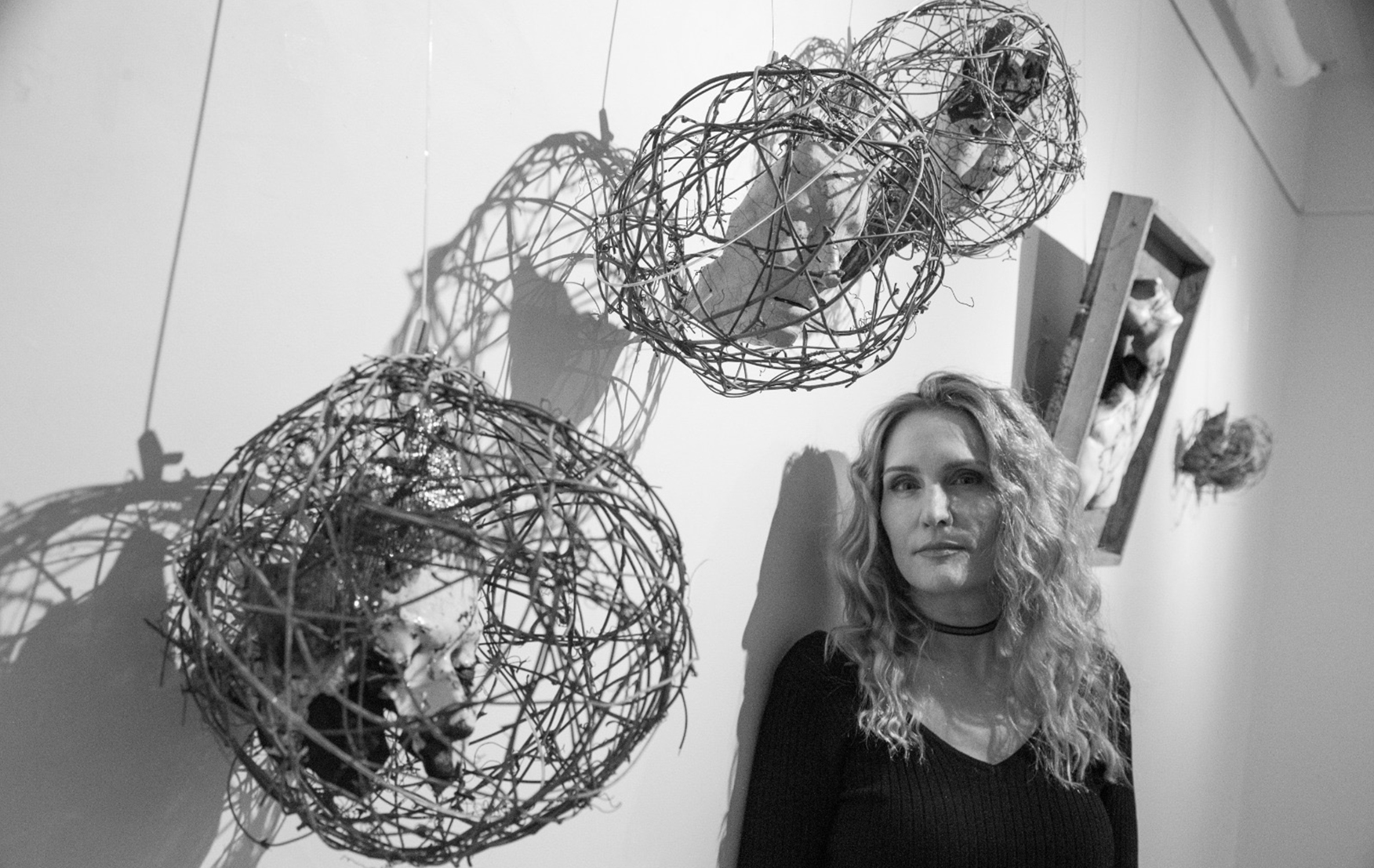 Trish Classe Gianakis, posed in front of her work.